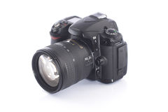 DSLR digital camera in the foreground. On white background Stock Photo