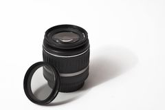 DSLR Lens with filter. Zoom lens with filter on white background stock image