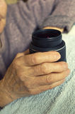 DSLR lens in woman's hands. Stock Image