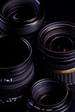DSLR Lenses. A group of isolated on black DSLR lenses royalty free stock photography