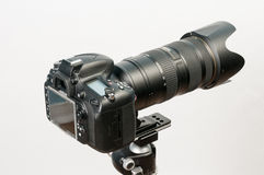 DSLR with long lens. DSLR camera mounter on tripod with long telephoto lens Royalty Free Stock Photography