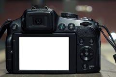 DSLR op onscherpe achtergrond met lichten royalty-vrije stock foto