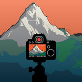 DSLR reflex camera photographing mountain landscape Stock Photos
