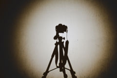 DSLR on tripod shadow Stock Images
