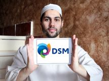 DSM company logo. Logo of DSM company on samsung tablet holded by arab muslim man. DSM is a Dutch multinational active in the fields of health, nutrition and royalty free stock photography