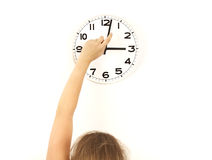 DST Daylight saving time, woman reseting clock Royalty Free Stock Image