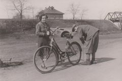 DT00077 HUNGARY CIRCA 1950 Man pumping a bycicle wheel royalty free stock photo
