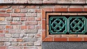 Détails d'architecture dans le style chinois, utilisant la brique et la porcelaine Images libres de droits