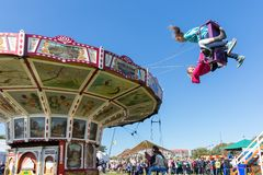 Dutch fair with unknown children at a wooden carou royalty free stock photography