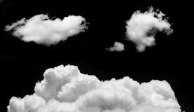 Dużo chmurnieją odosobnionego na czarnym tle Obrazy Stock