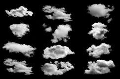 Dużo chmurnieją odosobnionego na czarnym tle Obraz Royalty Free