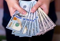 Dużo dolary w rękach zdjęcie royalty free