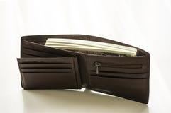 Dużo pieniądze w brown rzemiennej kiesie Zdjęcia Royalty Free