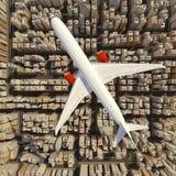Duży biały samolot nad ogromny miasto Zdjęcie Royalty Free