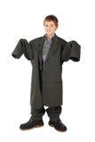 but duży chłopiec odizolowywał mężczyzna s pozyci kostium Fotografia Stock