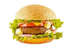 Duży hamburger z wołowiien warzywami na białym backgound i cutlet Zdjęcia Royalty Free