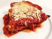 Duży kawałek Lasagna dla Obiadowego Dzisiaj wieczór Zdjęcie Royalty Free