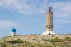Duży Utrish Rosja, Maj, - 17, 2016: Zabytek latarnia morska i kaplica na wyspie Utrish, budującej w 1975 w uznaniu al Zdjęcie Royalty Free