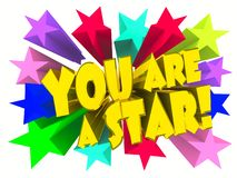Du är en stjärnaslogan Guld- text med livliga stjärnor royaltyfria bilder