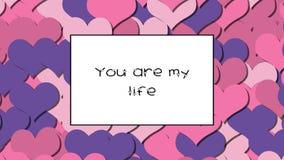 Du är mitt livförälskelsekort med rosa hjärtor som en bakgrund, zoomar in stock video