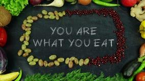 Du är vad du äter frukt stoppar rörelse royaltyfria foton