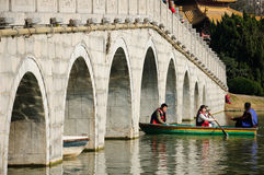 Du Jin Bridge in Hefei China. Chinese people rowing a boat on a lake under Du Jin bridge located in the Xiaoyaojin park in Hefei China Royalty Free Stock Images