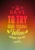 Du måste försöka vårt unga vin Typografisk retro design för stilvinlista på suddig bakgrund också vektor för coreldrawillustratio Royaltyfria Foton