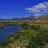 Du Noir Creek debajo de las nubes lenticulares fuera de Dubois Wyoming Imagen de archivo libre de regalías