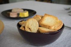 Du pain grillé et des pâtés Photo libre de droits
