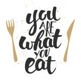 Du är vad du äter, modern färgpulverborstekalligrafi med färgstänk Arkivfoto