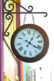 Dużych rozmiarów groszaka zegar z rzymskimi liczebnikami Obraz Stock