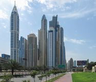 Dubaii, UAE - March, 02, 2017: Perspective from the street of the buildings in Dubai royalty free stock photography