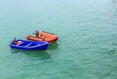The dual boat on sea. Royalty Free Stock Photography