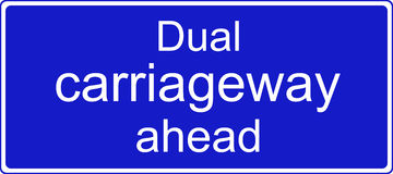 Dual carriageway ahead sign. Dual carriageway ahead road traffic sign Royalty Free Stock Image