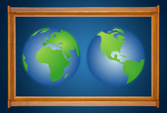 Dual earth in wooden picture modern frame. On blue Stock Photo