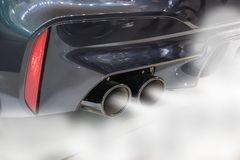 Dual exhaust pipe close up stock images