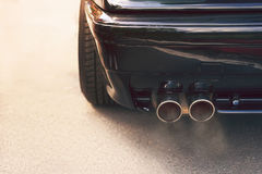 Dual exhaust pipe with smoke Stock Photo