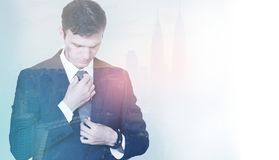 Dual exposure of a young businessman before his meeting, setting stock photography