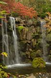 Dual Falls on a Fall Day. A view of dual falls on a fall day in a Japanese Garden stock photos