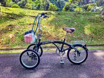 Dual front wheel bike. A unique adult tricycle with two front wheels and one rear wheel stock photos