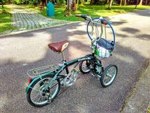 Dual front wheel bike. A unique adult tricycle with two front wheels and one rear wheel Royalty Free Stock Image