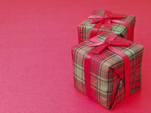 Dual gift on red Royalty Free Stock Photography