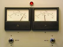 Dual panel meters. Front of a laboratory power supply showing dual readout panel meters Royalty Free Stock Photos