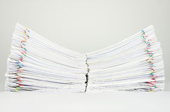 Dual pile overload document place on white background. Dual pile overload document of report and receipt with colorful paperclip place on white background Royalty Free Stock Images