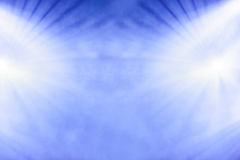 Dual radiating lights on blue Stock Image