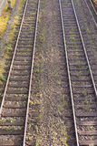 Dual Railway Tracks. Two parallel railway tracks in embankment of gravel Royalty Free Stock Photo