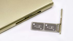 Dual SIM card slot. Nano SIM and memory card with ejector pin and tray for Touchscreen phone Royalty Free Stock Image