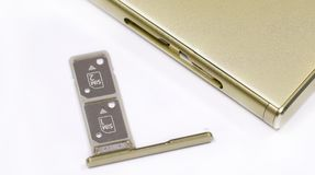 Dual SIM card slot. Nano SIM and memory card with ejector pin and tray for Touchscreen phone Stock Image