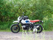 Adventure Motorcycle Parked in Backcountry. Dual sport adventure motorcycle parked in backcountry with green brush in background royalty free stock image