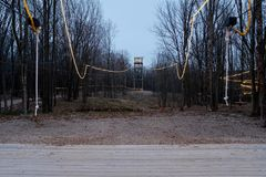 Dual Ziplines With Lights at Night. Dual ziplines in through trees in forest and tower and cables with at night stock images